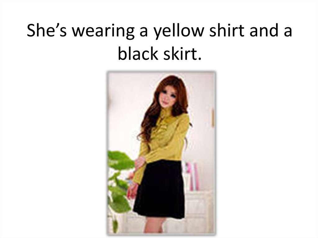She's wearing a yellow shirt and a black skirt.
