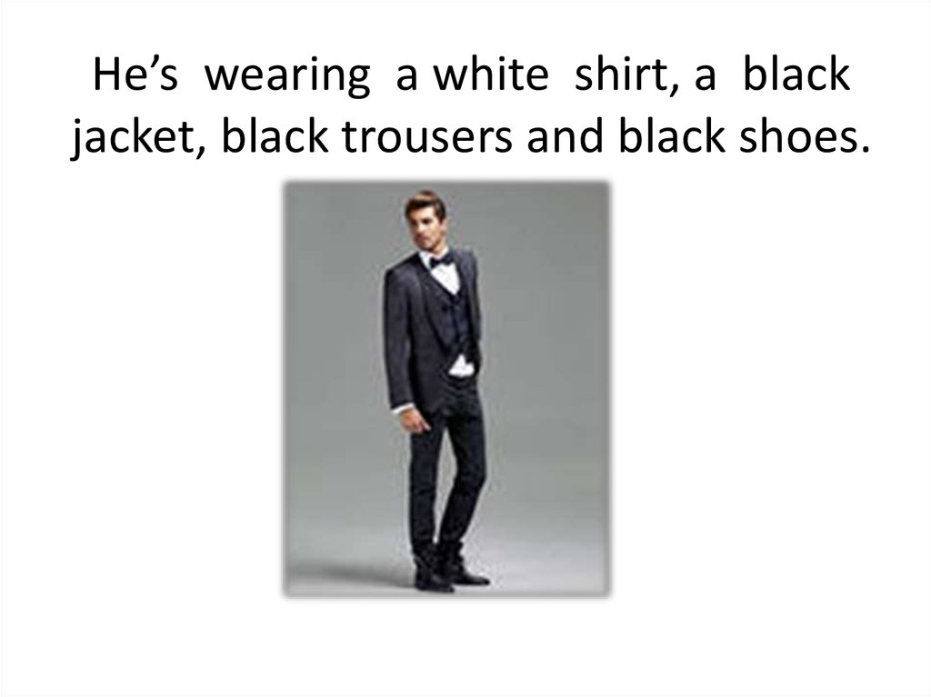 He's wearing a white shirt, a black jacket, black trousers and black shoes.