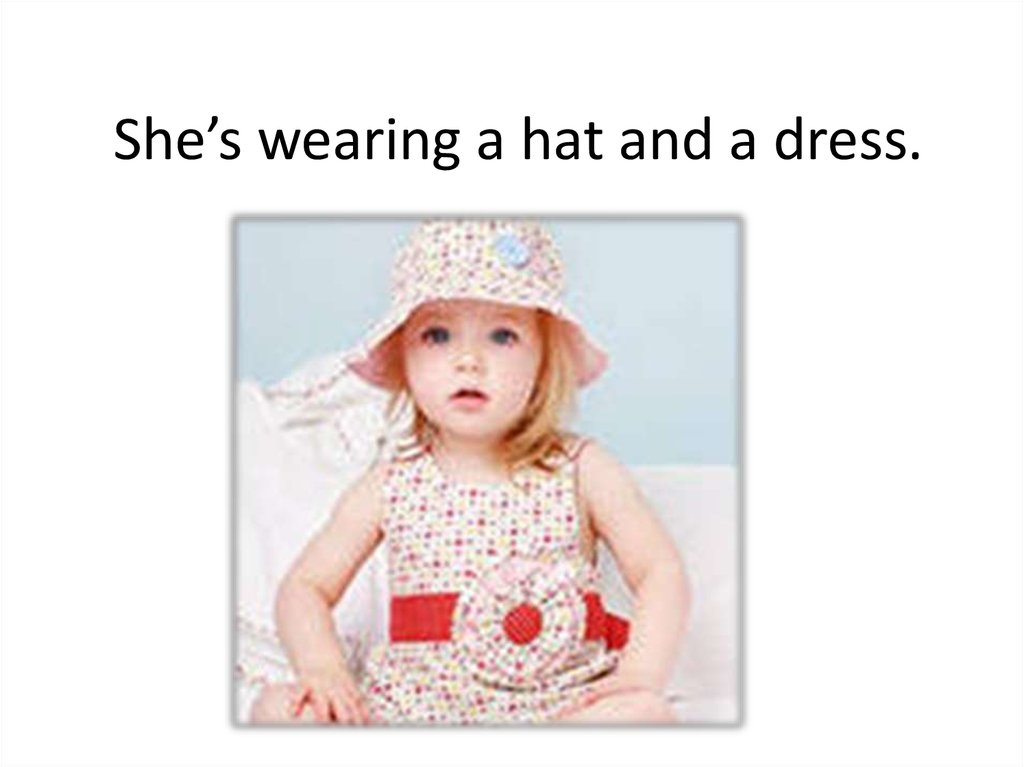 She's wearing a hat and a dress.