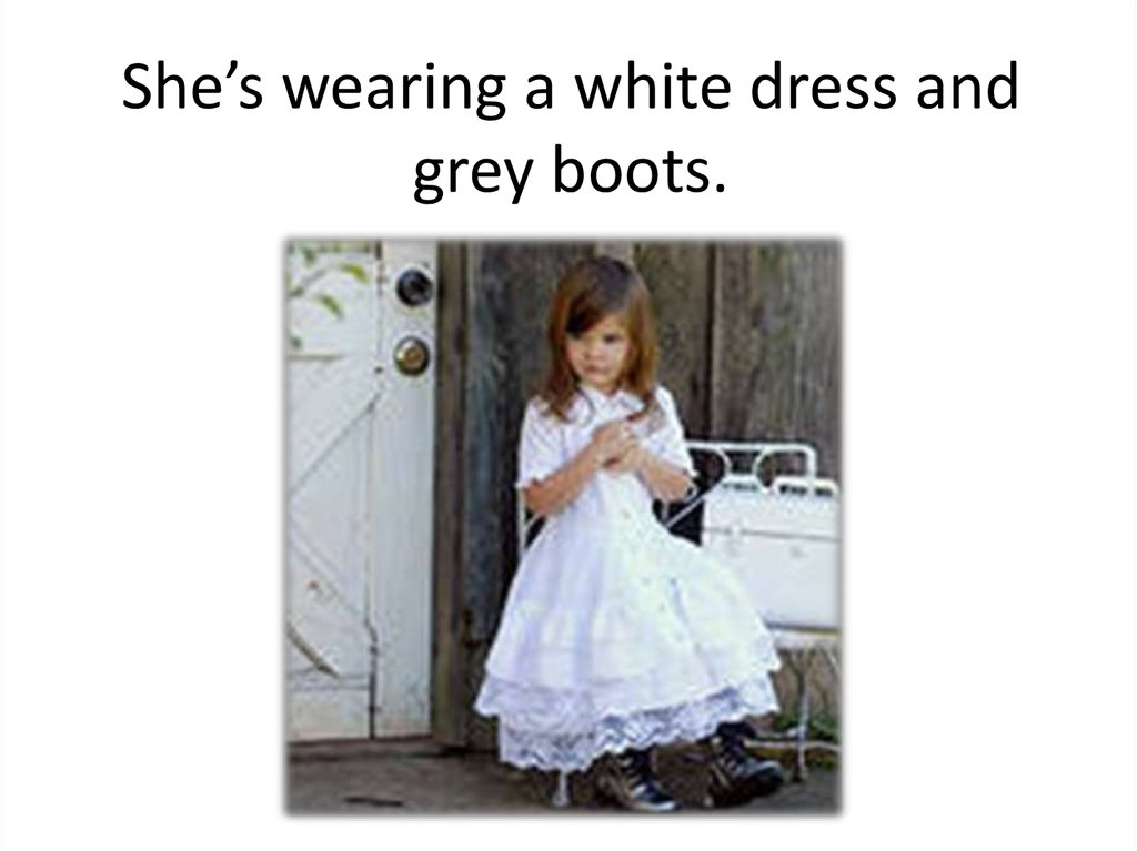 She's wearing a white dress and grey boots.